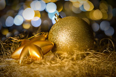 Gold christmas bauble and star decoration Royalty Free Stock Photo