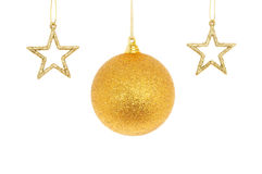 Gold Christmas bauble and stars Stock Photos