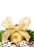 Gold Christmas bauble and tinsel. Gold Christmas bauble and green tinsel isolated on white background Royalty Free Stock Photography