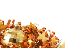 Gold Christmas bauble on tinsel Stock Images