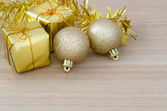 Gold Christmas bauble and Two Present Boxes Royalty Free Stock Photography
