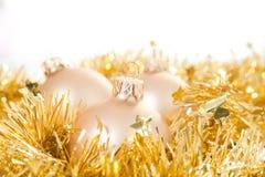 Gold Christmas baubles Stock Photos