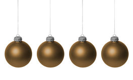 Gold Christmas baubles. Close up of row of four hanging gold Christmas baubles, isolated on white background Royalty Free Stock Photo