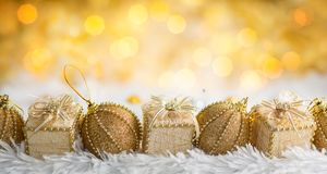 Gold Christmas baubles and gift boxes stock image