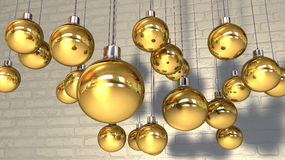 Gold Christmas Baubles Hanging Against A Wall Stock Image