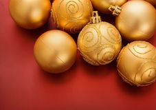 Gold christmas baubles on red Royalty Free Stock Photo