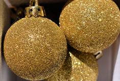 Gold Christmas Baubles. Sparkling and glittering in the light Stock Photos