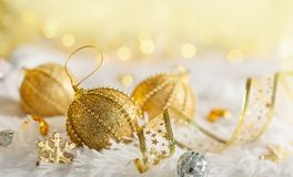 Gold Christmas baubles Royalty Free Stock Image