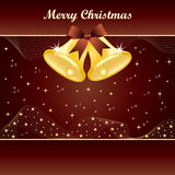 Gold christmas bells on brown Stock Photography