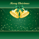 Gold christmas bells on green Royalty Free Stock Image