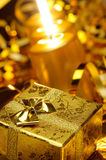 Gold christmas candles and gold gift boxes Stock Photography