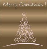Gold Christmas card. White Christmas Tree isolated on a gold background Stock Image