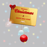Gold Christmas card with baubles and bow Royalty Free Stock Image
