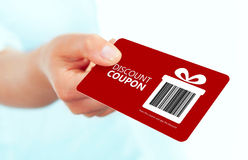 Gold christmas coupon holded by hand over white. Background. focus on coupon royalty free stock image