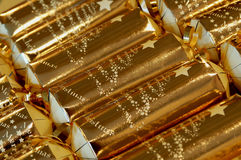 Gold christmas crackers. Close up of luxury gold christmas crackers Royalty Free Stock Photography