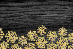 Gold christmas decor star on black wood texture background Stock Photography