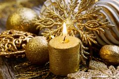 Gold christmas decoration with candle. Different gold christmas decoration with lighted candle Stock Photo