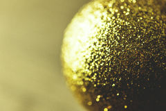 Gold Christmas decoration with glitter. Closeup of gold Xmas decoration ball stock image