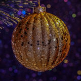 Gold Christmas Decoration. Hanging from the tree Stock Images