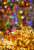 Gold Christmas decorations. Boxes, ribbons, stars, bells on the bokeh background Stock Image