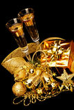 Gold Christmas decorations. Boxes, ribbons, stars, bells on black background Stock Photography