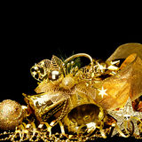 Gold Christmas decorations. Boxes, ribbons, stars, bells on black background Royalty Free Stock Photo