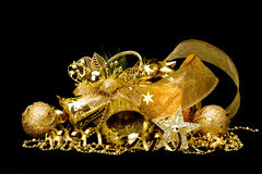Gold Christmas decorations. Boxes, ribbons, stars, bells on black background Stock Photo