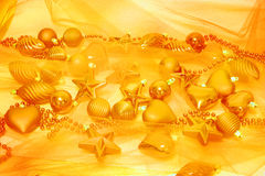 Gold christmas decorations. Lots of gold christmas decorations Royalty Free Stock Photo