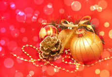 Gold Christmas decorations over red Royalty Free Stock Photo
