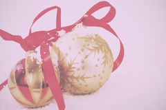 Gold Christmas decorations in white snow for background Vintage. Gold Christmas decorations in white snow for a background Vintage Retro Filter royalty free stock photo