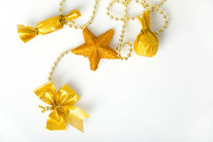 Gold christmas garland. With bow; star and sweets on chain royalty free stock photography