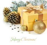 Gold Christmas gift. With balls and pinecones isolated on white background Royalty Free Stock Images