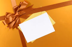 Gold christmas gift background ribbon bow, gift tag or label, copy space Royalty Free Stock Photo