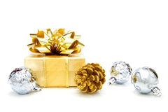 Gold Christmas gift with baubles Royalty Free Stock Images
