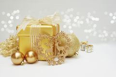 Gold Christmas gift and decorations. Against a silver bokeh lights background Stock Photo