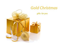 Gold christmas gifts Stock Photography