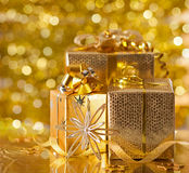 Gold Christmas gifts Stock Photos