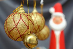 Gold christmas globes. Christmas globes and a little gold bell Royalty Free Stock Image