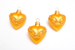 Gold Christmas hearts Stock Images