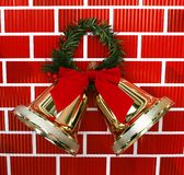 Gold Christmas Holiday Bells with Red Bow Royalty Free Stock Photo