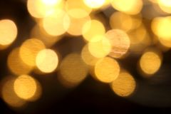 Gold Christmas lights soft focus bokeh background. Golden luxury Christmas lights soft focus bokeh background stock photography
