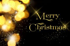Gold Christmas lights soft focus bokeh background with Merry Christmas. Golden luxury Christmas lights soft focus bokeh background and Merry Christmas stars and royalty free stock photography