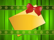 Gold Christmas message tag on a green background Royalty Free Stock Photography