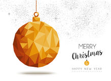 Gold Christmas and new year ornament in low poly. Merry christmas and happy new year gold xmas bauble ornament in low poly triangle style, holiday decoration Stock Images