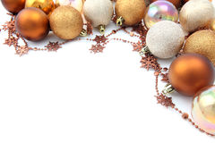 Gold Christmas ornament border. Christmas border with gold and brown ornaments isolated on white background. Shallow dof stock photo