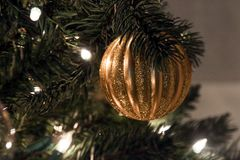 Christmas ornament on tree with lights Royalty Free Stock Image