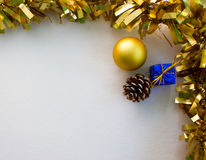 Gold Christmas ornament flat composition on white board. Golden ribbon. stock images