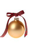 Gold Christmas ornament glass ball with plaid ribbon. This stock photo shows a simple gold Christmas ornament glass ball with a red and green plaid ribbon bow Royalty Free Stock Image