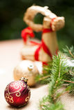 Gold Christmas ornament on leaves Stock Photography