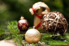 Gold Christmas ornament on leaves Stock Photo